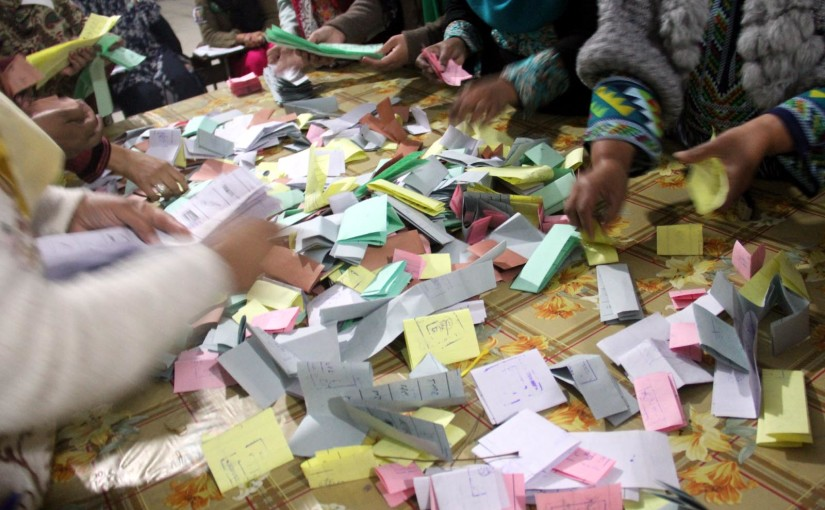 ISLAMABAD: Polling staff counting the ballots at a polling station in Sector G-7. INP PHOTO by Sulaman Qureshi